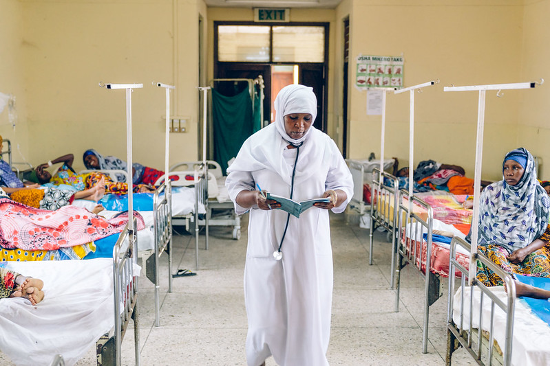 nurse walks hallway of maternity ward